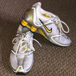 White and yellow Nike Shox